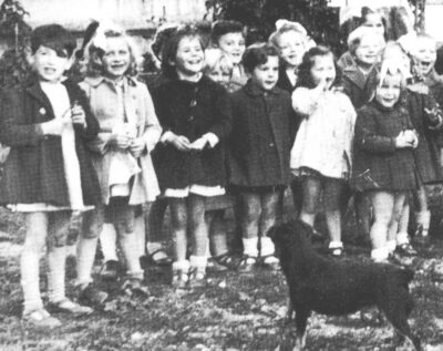Raincy-le-Plateau orphanage 1946: Suzanne (second from left) with other children and their dog, Zezette.